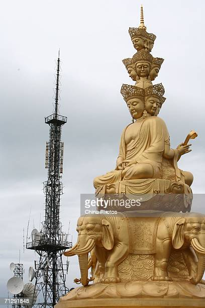 The Puxian Bodhisattva Statue is seen near the highest TV transmission tower of Sichuan Province at Emeishan Mountain on June 24 2006 in Emeishan of...