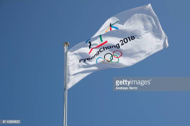 The PyeongChang 2018 Winter Olympic Games flag flies during the inauguration of the Olympic truce mural during previews ahead of the PyeongChang 2018...