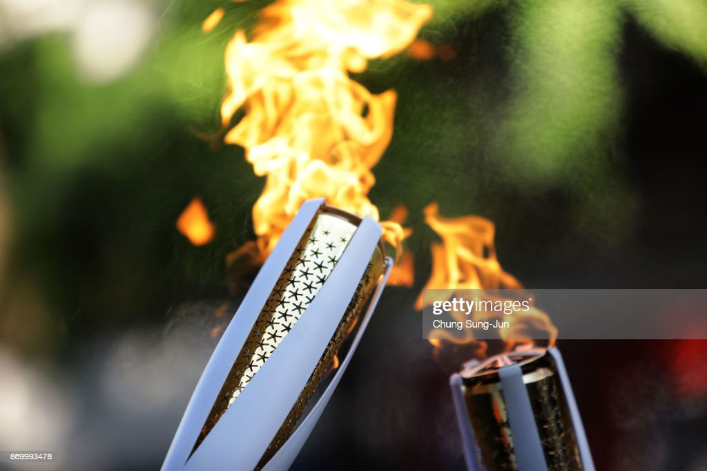 The PyeongChang 2018 Winter Olympics torch is seen during the PyeongChang 2018 Winter Olympic Games torch relay on November 4, 2017 in Busan, South Korea.