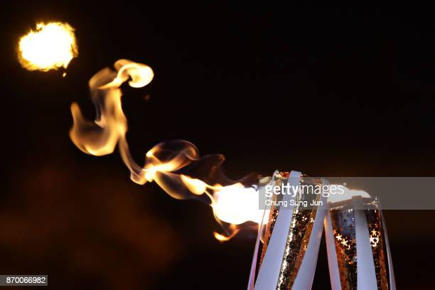 The PyeongChang 2018 Winter Olympics torch is seen during the PyeongChang 2018 Winter Olympic Games torch relay on November 4 2017 in Busan South...