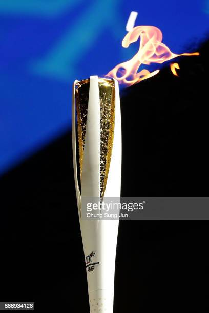 The PyeongChang 2018 Winter Olympics torch is seen to celebrate 100 days to go and the PyeongChang 2018 Winter Olympics torch during a torch relay on...