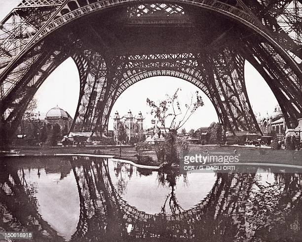 The pylons of the Eiffel Tower during the Paris World Exposition from the Revue de l'Exposition Universelle France 19th century