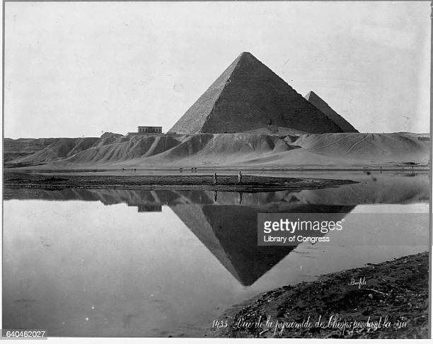 The Pyramid of Cheops stands reflected in the flooded Nile River Giza Egypt