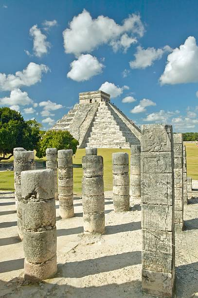 The Pyramid of Kukulkan, (also known as El Castillo), a Mayan ruin, as seen from the Thousand Columns (foreground), Chichen Itza, Mexico