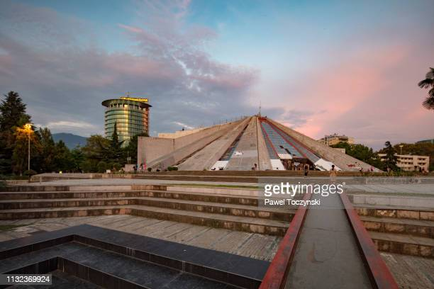 the pyramid of tirana, unveiled in 1988 as enver hoxha's museum, tirana, albania, 2018 - socialism stock pictures, royalty-free photos & images