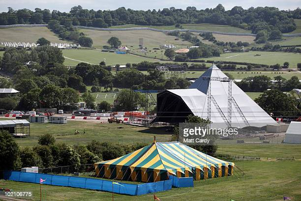 The Pyramid stage begins to take shape at the Glastonbury Festival site at Worthy Farm Pilton on June 15 2010 in Glastonbury England The gates open...