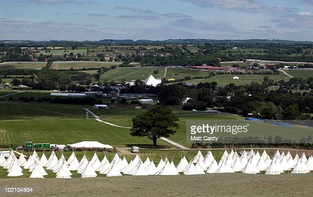 The Pyramid stage can be seen beyond recently erected tipis at the Glastonbury Festival site at Worthy Farm Pilton on June 15 2010 in Glastonbury...