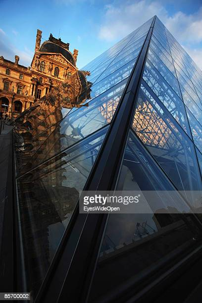 The Pyramide at the famous Louvre museum and the Jardin des Tuileries in Paris France on February 252009