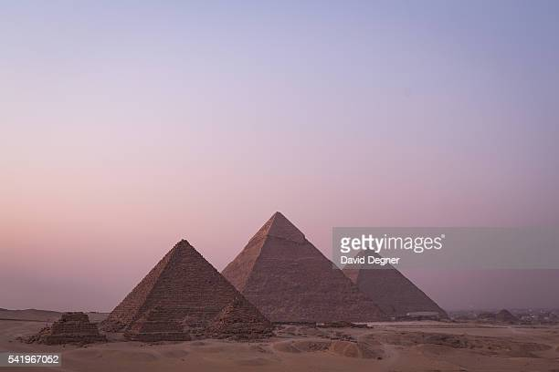 The Pyramids of Giza at sunset on July 28 2015 in Cairo Egypt Giza pyramid complex bordering what is now El Giza Egypt It is the oldest of the Seven...