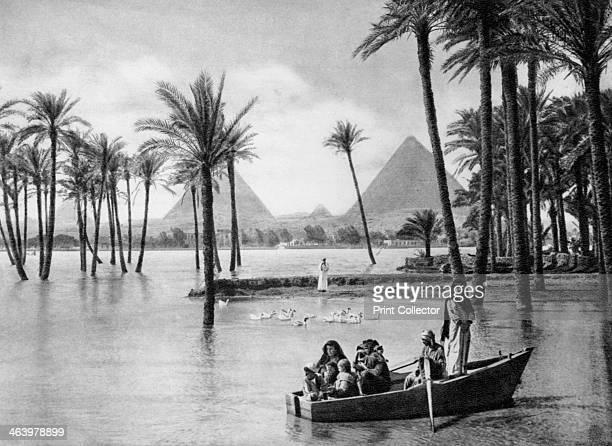 The Pyramids of Giza during a flood Cairo Egypt c1920s Plate taken From In the Land of the Pharaohs published by Lehnert Landrock