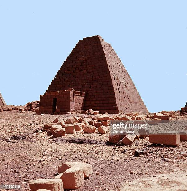 The pyramids of the Meroitic kings and queens in the north cemetery Meroe built on a ridge overlooking the ruined city 300 BC400 AD Nubian Country...