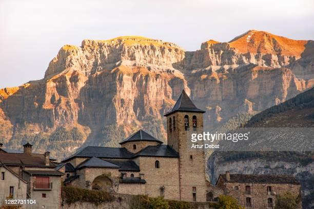 the pyrenees mountains in ordesa national park with the torla town. colores de otoño en el parque nacional de ordesa en los pirineos. - aragon stock pictures, royalty-free photos & images