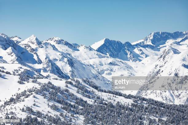 the pyrenees mountains in winter in val d aran catalonia spain - catalonia stock pictures, royalty-free photos & images