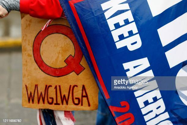 The QAnon conspiracy theorists hold signs during the protest at the State Capitol in Salem Oregon United States on May 2 2020 Demonstrators protested...