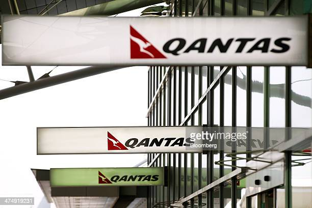 The Qantas Airways Ltd logo is displayed at the company's domestic terminal at Sydney Airport in Sydney Australia on Wednesday Feb 26 2014 Qantas...