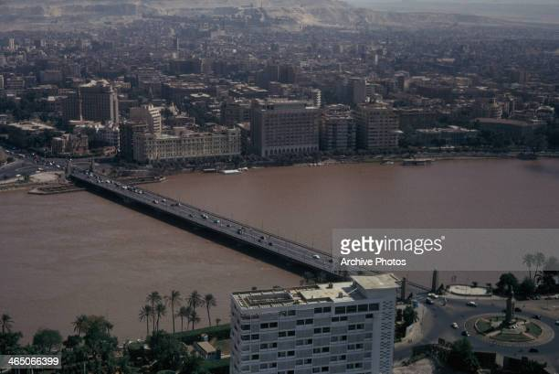 The Qasr alNil Bridge across the River Nile as seen from the Cairo Tower on Gezira Island Cairo Egypt circa 1960 Opera Square is in the bottom right...