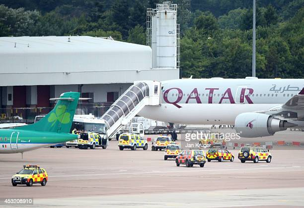 The Qatar Airways flight from Doha sits on the tarmac after having a military escort into Manchester Airport, a man has been arrested on suspicion of...