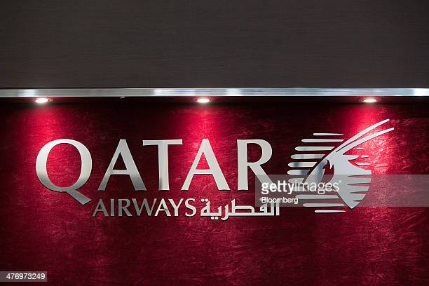 The Qatar Airways Ltd logo sits on display at the company's stand during the ITB travel fair at Messe Berlin exhibition center in Berlin Germany on...