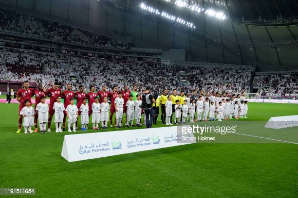 The Qatar and UAE national teams line up before their Gulf Cup group stage match at the Khalifa International Stadium in Doha, Qatar on December 2...