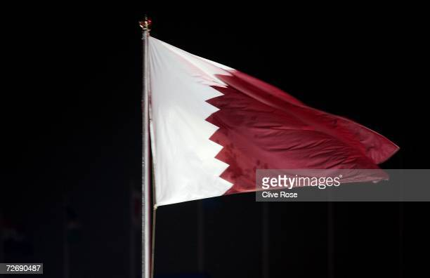 The Qatar flag is raised to a huge applause during the Opening Ceremony of the 15th Asian Games Doha 2006 at the Khalifa stadium on December 1 2006...