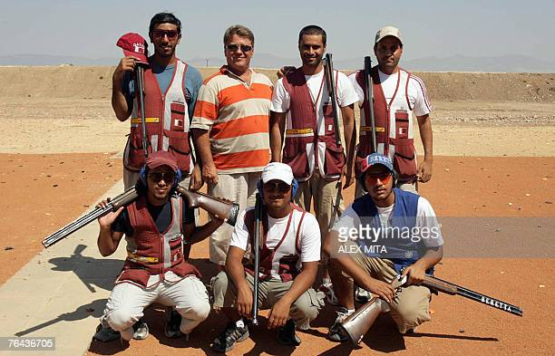 The Qatar National Shooting team poses for a picture during practise for the ISSF World Shooting Championship at the Olympic Shooting Centre in...