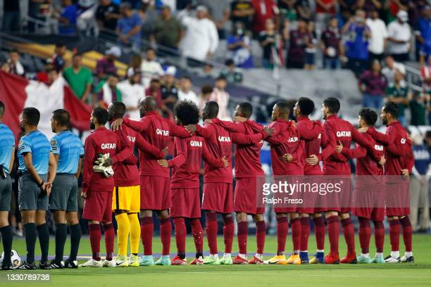 The Qatar soccer team join together during the playing of the country's national anthem prior to the Concacaf Gold Cup quarterfinal match between...