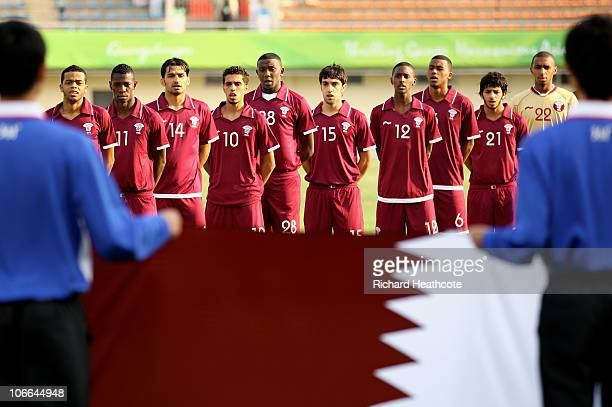 The Qatar team sing their national anthem prior to kickoff during the Men's Football group D pool match between Qatar and India ahead of the 16th...