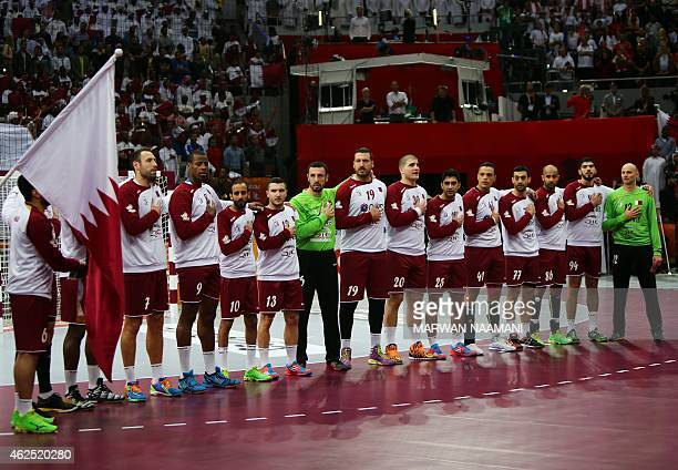 The Qatari national team stands at attention during the 24th Men's Handball World Championships semifinals match between Qatar and Poland at the...