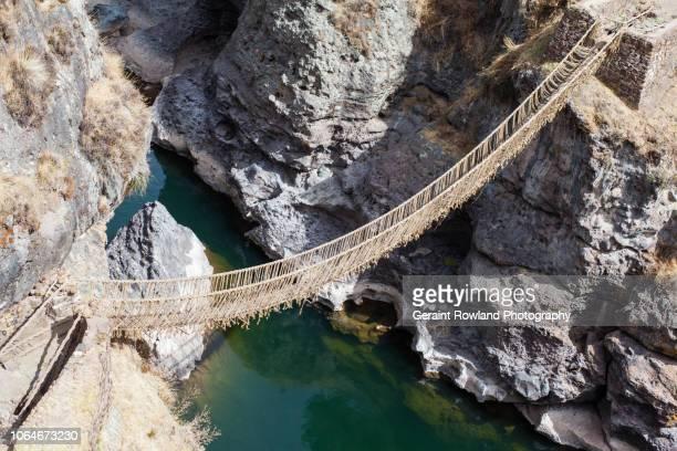 the q'eswachaka inca bridge near cusco, peru - inca stock pictures, royalty-free photos & images