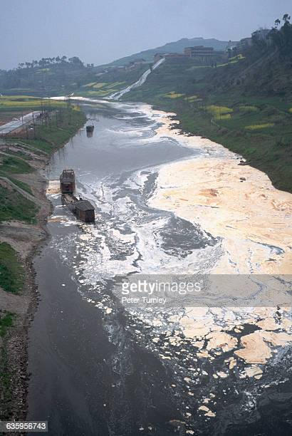 The Qingai River along the Yangtze near Chongqing in Sichuan Province is polluted by a paper mill | Location Near Chongqing China
