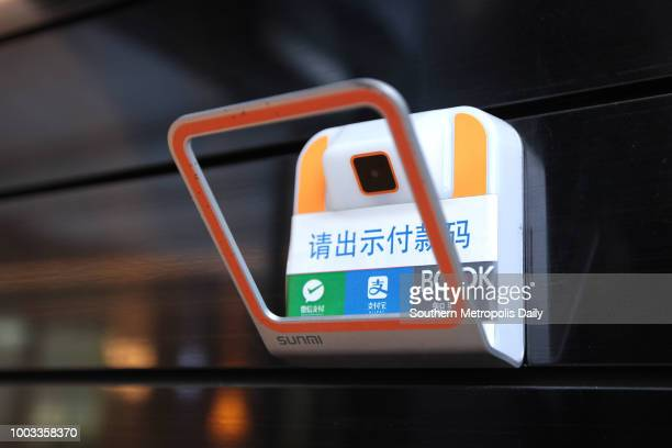 The QR code scanning machine is seen at the entrance of an unmanned bookstore on July 17 2018 in Shenzhen Guangdong Province of China Customers can...