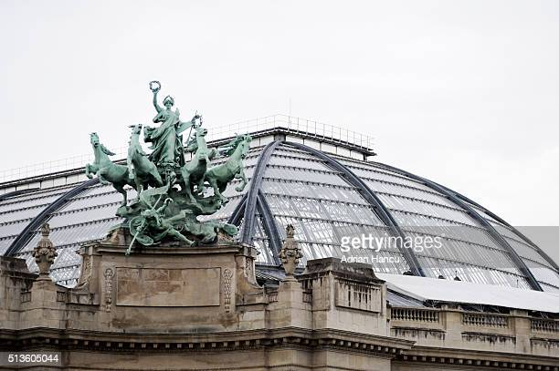 The quadriga on the Champs-Elysees side - Immoratality outstripping Time - statue of horses and lady on top of Grand Palais