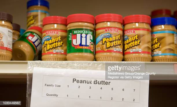 The quanity of peanut butter a family can select is listed according to the amount of family members at the South County Outreach food pantry in...