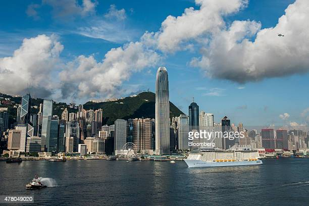 The Quantum of the Seas cruise ship operated by Royal Caribbean Cruises Ltd right sails through Victoria Harbor in front of Two International Finance...