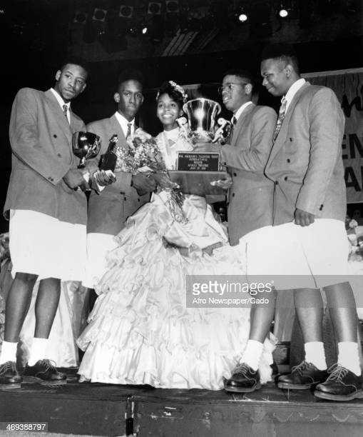 The quartet of singers Boyz II Men crowning the winner of the Hal Jackson's Talented Teens International competition in Baltimore a 17 year old tap...