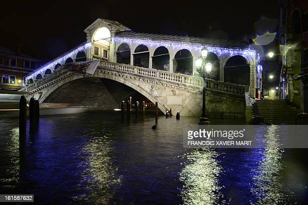 The quay is flooded near the Rialto bridge during an acquaalta late on February 11 2013 in Venice The 'acqua alta' a convergence of high tides and a...