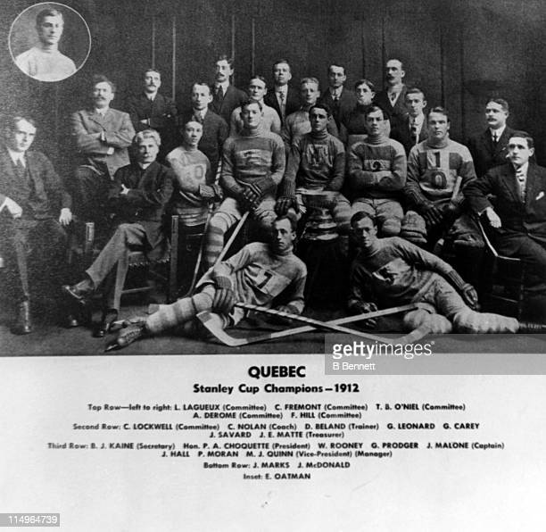 The Quebec Bulldogs team pose for a portrait circa 1912 after winning the Stanley Cup The players from LR top row Louis Lagueux C Fremont TB O'Neil A...