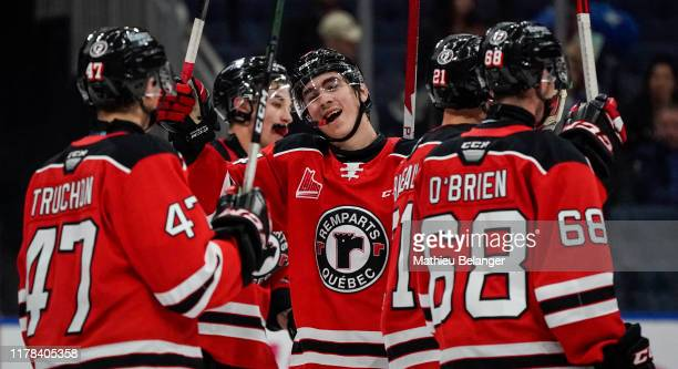 The Quebec Remparts players celebrate their victory against the Shawinigan Cataractes during their QMJHL hockey game at the Videotron Center on...