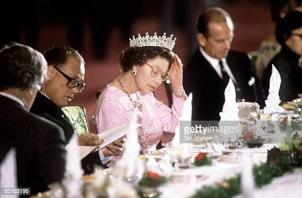 The Queen Adjusting Her Tiara Whilst Reading The Menu Before Dinner Is Served At A Banquet Held In Her Honour During Her Visit With Prince Philip To...