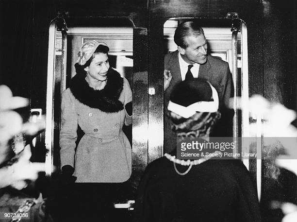 The Queen and Duke of Edinburgh bid farewell to onlookers as the Royal Train departs from Sunderland station 29 October 1954
