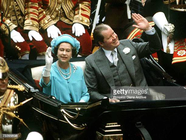 The Queen and Earl Spencer travel from St Paul's Cathedral by carriage after the wedding of their respective son and daughter now the Prince and...