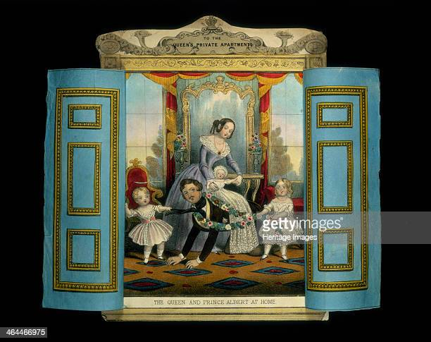 'The Queen and Prince Albert at Home' Queen Victoria and Prince Albert depicted in an informal setting playing with their young children