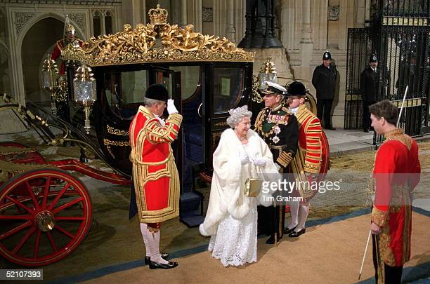 The Queen And Prince Philip Arrive In The Irish State Coach At The House Of Lords For The State Opening Of Parliament.the Footman Saluting The Queen...