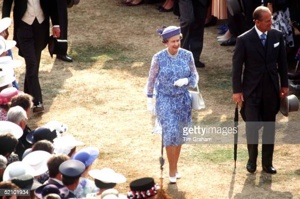 The Queen And Prince Philip At A Buckingham Palace Garden Party