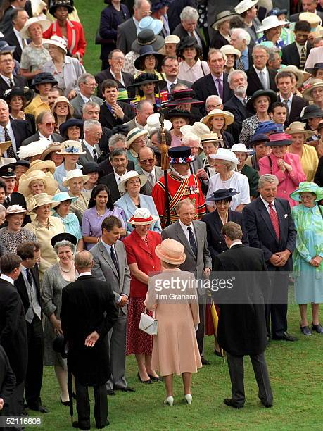 The Queen And Prince Philip Chatting To Guests At A Buckingham Palace Garden Party