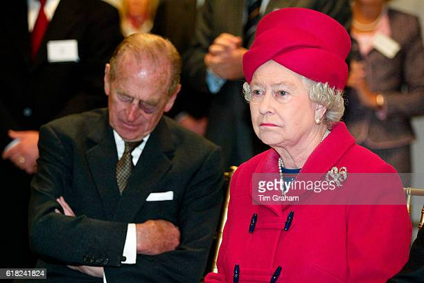 The Queen and Prince Philip listen to a presentation on energy production during a tour of the new Baglan Power Station in Port Talbot.