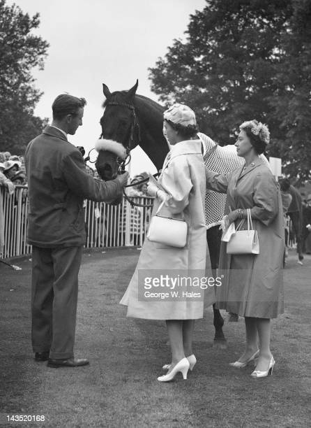 The Queen and Princess Margaret with the Queen's racehorse Restoration in the unsaddling enclosure at Ascot 19th June 1958