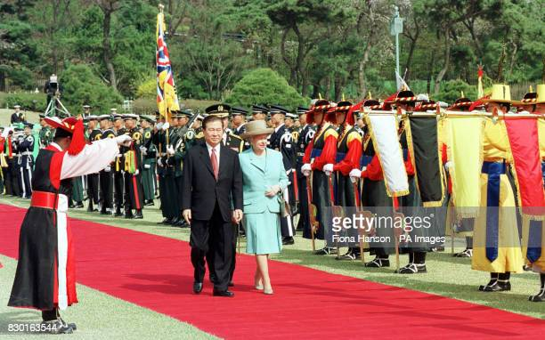 The Queen and South Korea's President Kim DaeJung review an honour guard at the Blue House presidential residence in the South Korean capital Seoul...