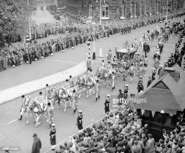 The Queen and the Duke of Edinburgh in the gold state coach in Northumberland Avenue as she makes way to Westminster Abbey for her coronation 2nd...