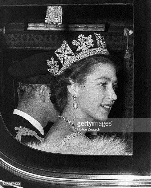 The Queen and the Duke of Edinburgh leave Buckingham Palace on their way to the Houses of Parliament for the Queen to perform the first State Opening...